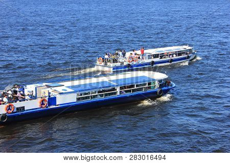 St. Petersburg, Russia - July 18, 2018: Excursion And Tour Cruise Boats On Neva River Water. Cruise