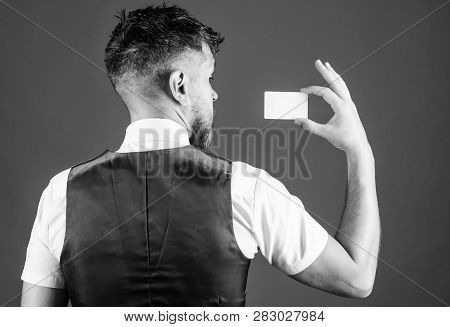 Man Hold Plastic Blank Card Blue Background Rear View. Take This Card. Banking And Credit Concept. P