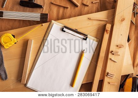 Mock Up Template Clipboard Note Paper As Copy Space In Woodwork Carpentry Workshop, Top View