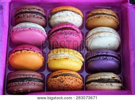 Assorted French Macarons In A Pink Box.