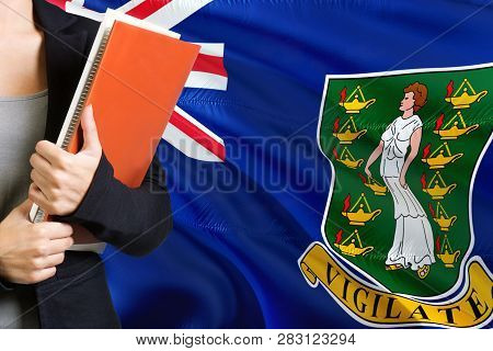 Learning Language Concept. Young Woman Standing With The British Virgin Islands Flag In The Backgrou