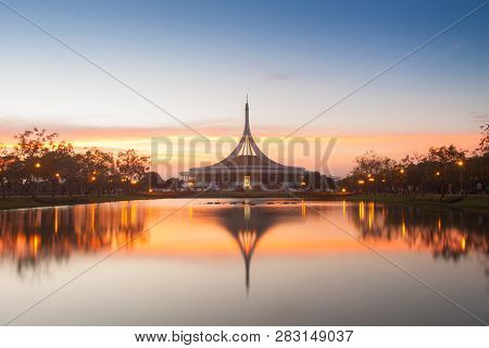 Monument In Public Park Of Thailand. Twilight Shooting Reflection On Water Concept At The Suanluang