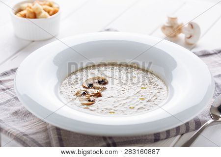 Mushroom Cream Soup In White Plate Side View