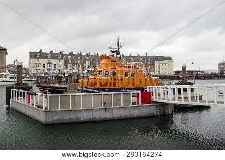 Weymouth, Dorset, Uk - December 26. 2017. Lifeboat Moored At Weymouth Old Harbour, A Coastal Town In
