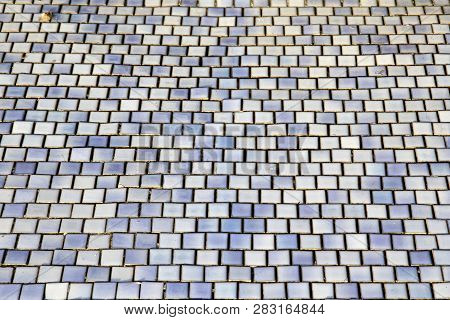 Mosaic Pattern Made From Small Square Ceramic Tiles