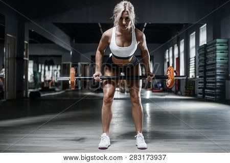 Beautiful Strong Sexy Athletic Muscular Young Caucasian Fitness Woman Workout Barbell Squat Training