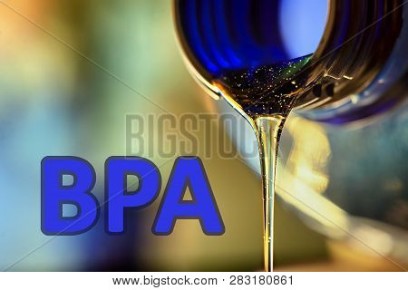 Plastic Bottle And Liquid Stream. Bisphenol, Text Bpa Free Plastic Photo