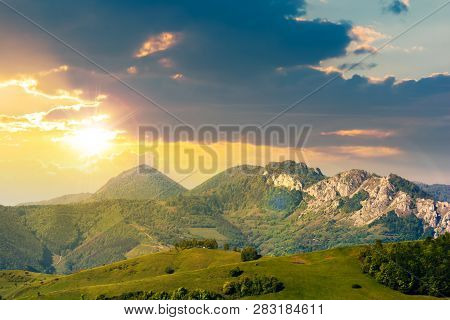 Landscape In Mountains With Rocky Formations. Grassy Meadows, Forested Hills And Huge Cliffs. Wonder