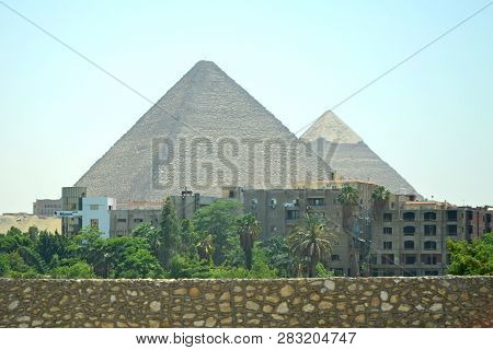Cairo, Egypt - 19th May, 2018: View Of The Pyramid Of Cheops And Khafre On The Background Of The Cit