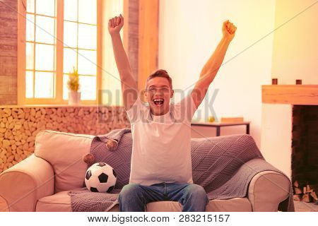 Jovial Exuberant Guy Cheering On Football Team