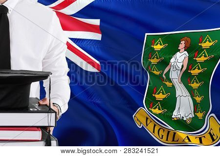 Successful Student Education Concept. Holding Books And Graduation Cap Over British Virgin Islands F