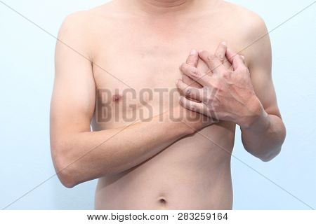 Man Holding His Chest With Both Hands, Having Heart Attack Or Painful Cramps