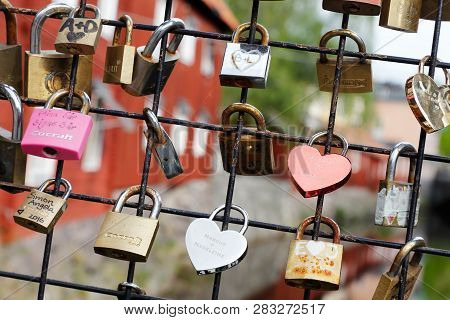 Vasteras, Sweden - May 20, 2017: A Bridge Fence With Pad Locks As A Symbol Of Love.