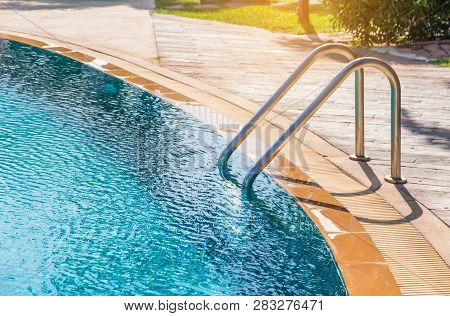 Modern Backyard Of A Swimming Pool In Public Resort Or Clubhouse