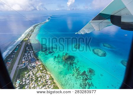 Tuvalu Under The Wing Of An Airplane. Aerial View Of Funafuti Atoll And The Airstrip Of Internationa