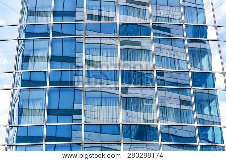 Abstract Architecture Background. Sky And Building Are Reflected In The Office Skyscraper Facade. Co
