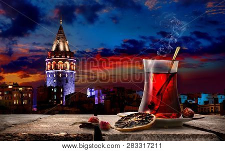 Tea And Galata Tower In Istanbul At Night, Turkey