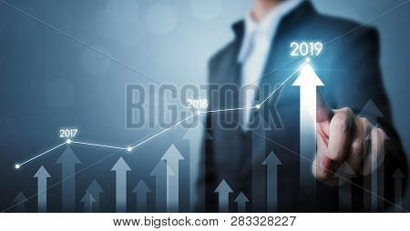 Business Development To Success And Growing Growth Year 2019 Concept, Businessman Pointing Line Dot
