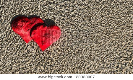 stone hearts on sand