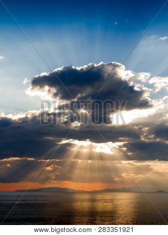 Crepuscular Rays On Follonica Gulf In Tuscany, Italy