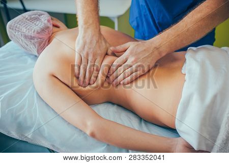 Massage Therapist Making Massage With Two Or Four Hands. Face Massage. Herbal Massage.