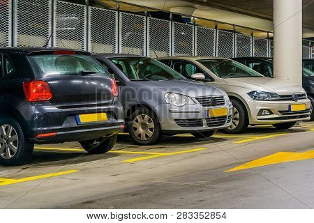 Row Of Cars Parked In A Indoor Parking Garage, Commercial Parking Lot