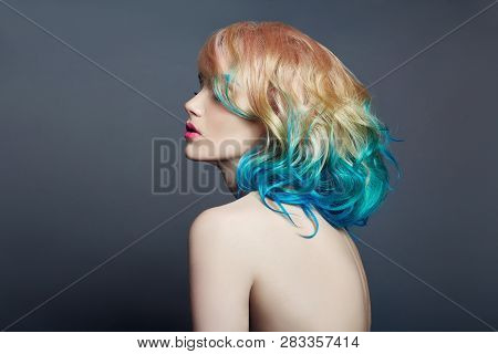 Portrait Woman With Bright Colored Flying Hair, All Shades Of Purple Blue. Hair Coloring, Beautiful