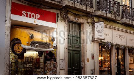 Lisbon, Portugal - 01/03/19: Car Cut In Half Used As Shop Sign For Stop Shop In Downtown Chiado. Yel