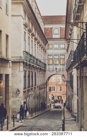 Lisbon, Portugal - 01/03/19: Rose Street Arch Bairro Alto (rua Da Rosa). Arch In Narrow Rose Street,