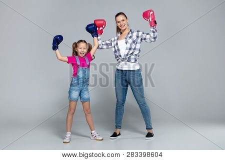 Fitness Woman And Her Daughter Are Boxing