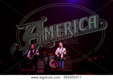 HUNTINGTON, NY - FEB 8: Dewey Bunnell (L) and Gerry Beckley of America perform in concert at the Paramount on February 8, 2019 in Huntington, New York.