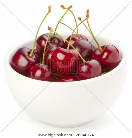 Red ripe cherries in a white bowl isolated on white background