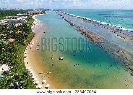 Aerial View Of Muro Alto Beach, Porto De Galinhas, Brazil: Vacation In The Paradisiac Beach With Fan