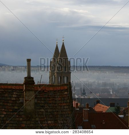 roofs and towers with fog in Pecs poster