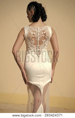 Amazing Dress. Woman Hairstyle Wears Fashionable Tight Fitting Dress With Embroidery And Pearls. Lad
