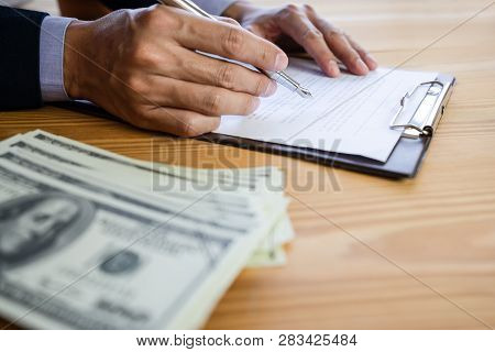 Business Man Signing A Contract. Owns The Business Sign Personally,director Of The Company, Solicito