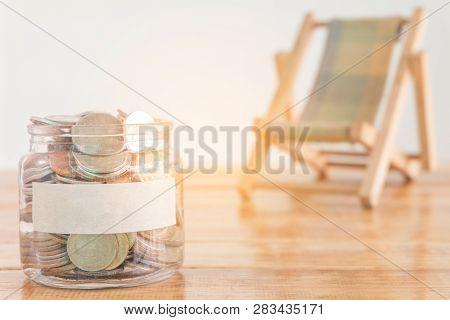 Budget Concept, Money Savings Concept. Collecting Money In The Money Jar For Your Concept. Money Jar