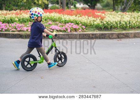 Cute Little 2 - 3 Years Old Toddler Boy Child Wearing Safety Helmet Learning To Ride First Balance B