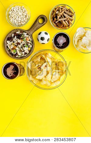 Snacks For Watching Football On Tv. Watching Sports. Chips, Nuts, Rusks Near Beer And Soccer Ball On