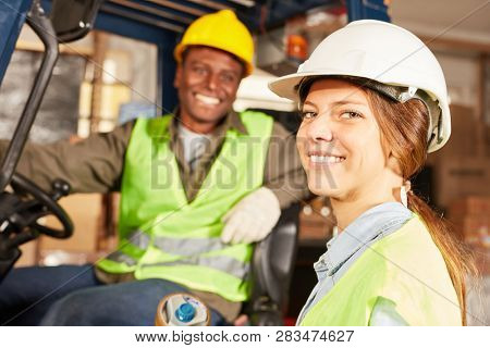 Logistics woman as a worker in training to warehouse specialist in the warehouse