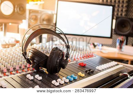 Radio Station: Headphones On A Mixer Desk In An Professional Sound Recording Studio