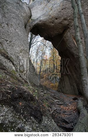 Obrovska Brana Natural Arch In Sulovske Skaly Mountains In Slovakia With Colorful Trees On The Backg