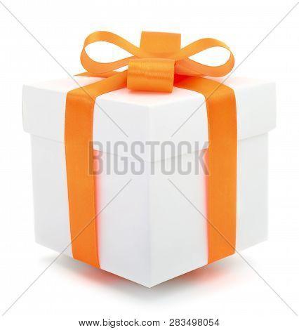 White Gift Box With Orange Ribbon Isolated On White Color Background.