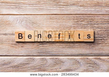 Benefits Word Written On Wood Block. Benefits Text On Wooden Table For Your Desing, Concept