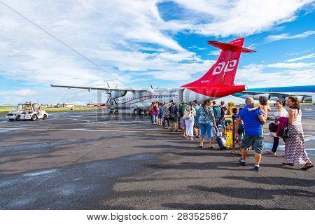 Faaa, French Polynesia - Nov 06 2017. Happy Tourists Boarding Air Tahiti Atr 72 Tapuata On Their Way