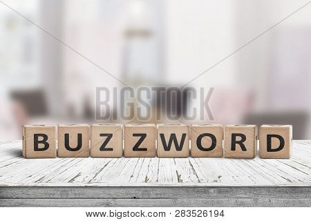 Buzzword Made Of Wooden Blocks On A Table In A Bright Room In Daylight