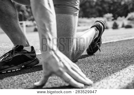 Starting Point. Hand Of Sportsman On Running Track Low Start Position. Runner Ready To Go Close Up.