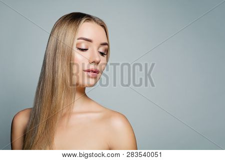 Beautiful blonde straight hair model. Pretty woman portrait. Facial treatment, haircare and cosmetology concept poster