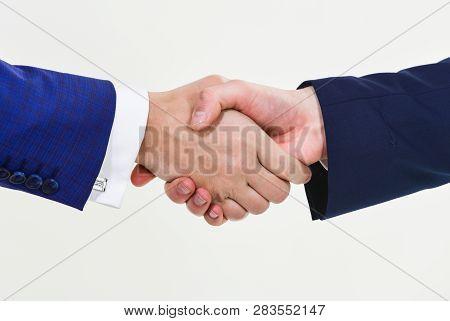 Successful Deal Handshake White Background. Shaking Hands At Meeting. Friendly Handshake Gesture. Ha