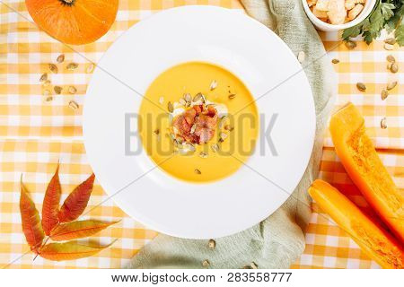 Pumpkin Cream Soup Bowl Healthy Food Flat Lay. Creamy Squash Thanksgiving Bacon Puree Meal For Lunch